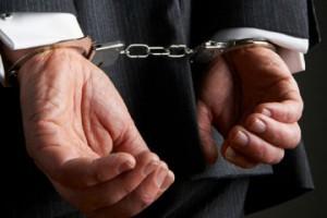 арестован