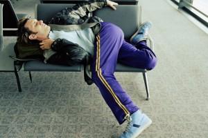 Man-sleeping-in-airport